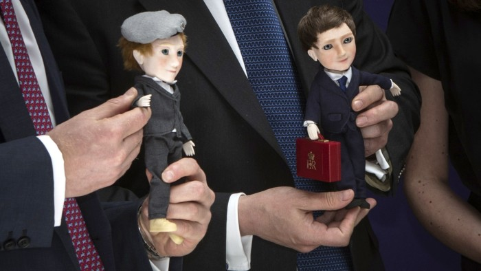 Prince Harry and British Prime Minister David Cameron were presented with dolls of themselves by MakieLab company co-founder Jo Roach in New York City on May 14, 2013.