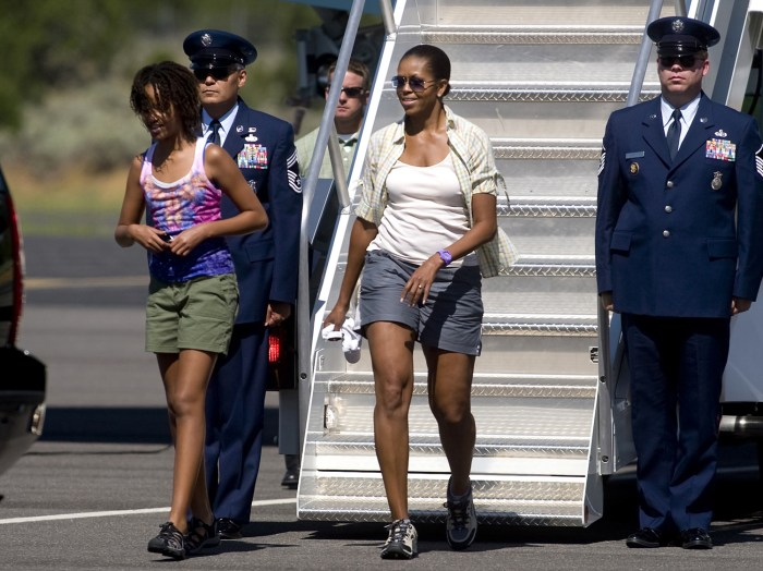 First lady Michelle Obama and daughter Malia Obama, walk off Air Force One at Grand Canyon National Park Airport in Tusayan, Ariz.,  Sunday, Aug. 16, ...