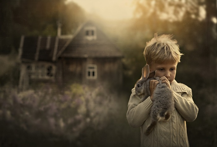 Five-year-old Yaroslav Shumilova holds one of his family's rabbits.