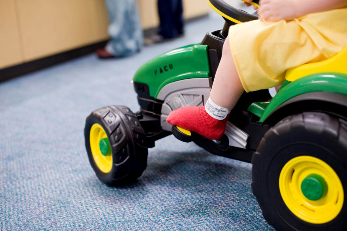 Sometimes, kids are so excited about riding a pedal car (or tractor) through the hospital, they forget to be scared about their surgery.