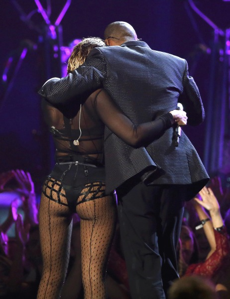 "Beyonce and  Jay-Z  hug as they walk offstage after performing ""Drunk In Love"" at the 56th annual Grammy Awards in Los Angeles, California January 26,..."