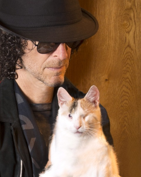 Howard Stern cuddles with his adopted cat, Bella, who is blind.