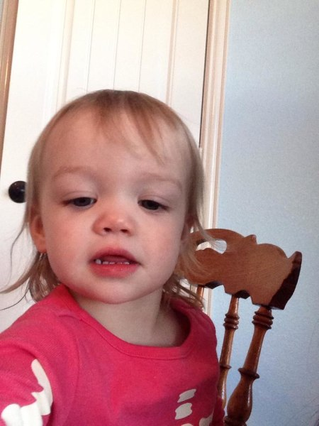 My 18 month old, Audrey, taking her first selfie. There were about 10 more right after this one.