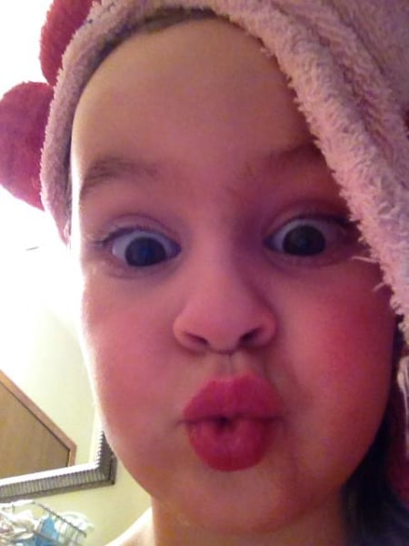 My 4 year old doing the duck face after her bath.