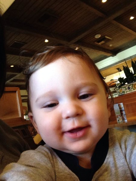 """My 10 month old son playing with the iPhone has no problem with finding the """"cheese"""" button"""