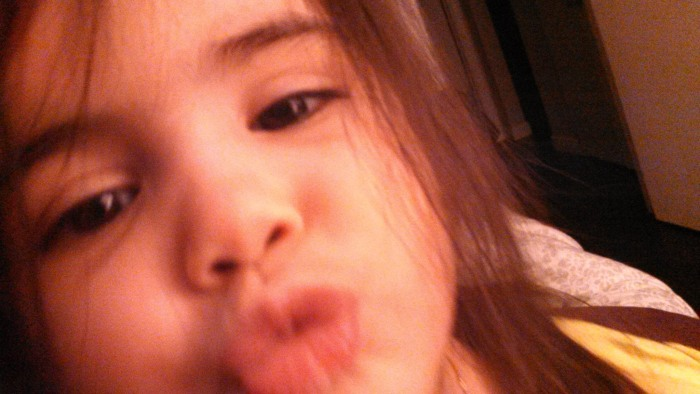 My daughter loves to give herself kisses!