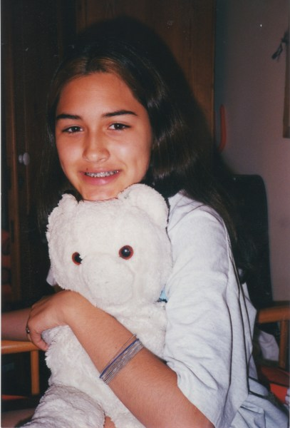 """A childhood photo of Jessica Crawford with her beloved teddy bear """"Whitey."""""""
