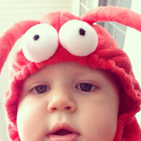 Aiden playing with my phone on Halloween -- he was a lobster.