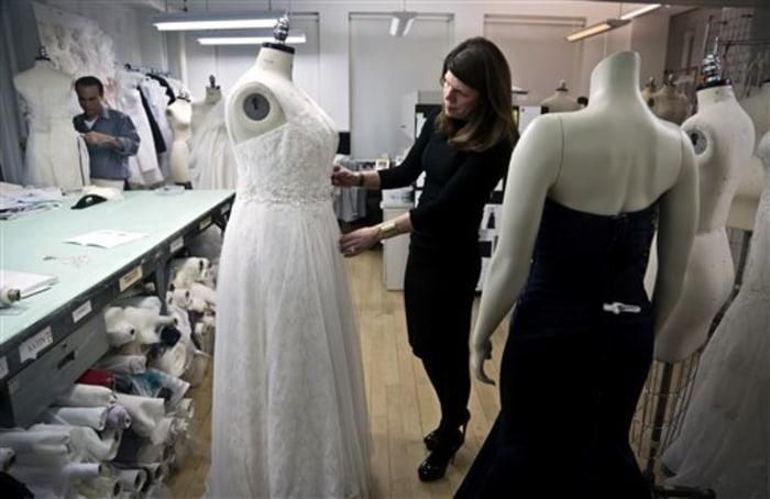 David's Bridal senior vice president Michele von Plato arranges a dress on a plus-size mannequin in New York.