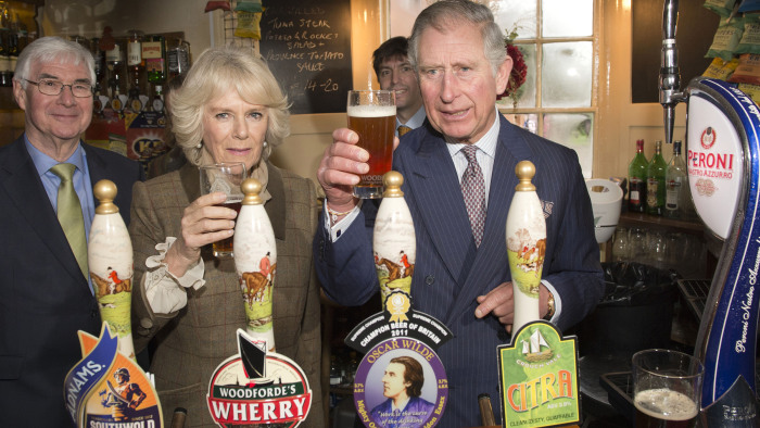 "Camilla, Duchess of Cornwall and Prince Charles, Prince of Wales drink beer during a visit to ""The Bell"" pub during an official visit to Essex on January 29."