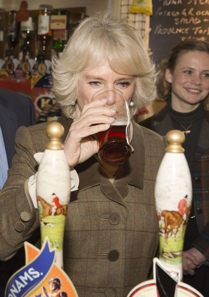 Camilla, Duchess of Cornwall, samples a pint of draught beer during a visit to The Bell pub in Purleigh on January 29.