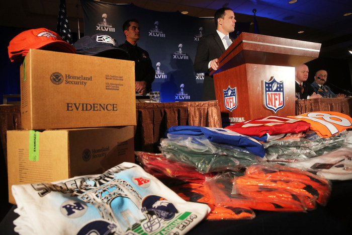 Officials from the National Football League,  U.S. Immigration and Customs Enforcement and U.S. Customs and Border Protection displayed recently confiscated counterfeit items while also showing phony websites that have been set-up to sell Super Bowl XLVIII  merchandise. Counterfeit sports merchandise, much of which originates in China, is a multimillion-dollar industry.
