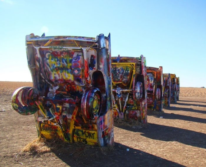 Located on I-40, outside of Amarillo, Texas, Cadillac Ranch is a wholly interactive exhibit. Visitors are encouraged to bring paint, markers, or whate...