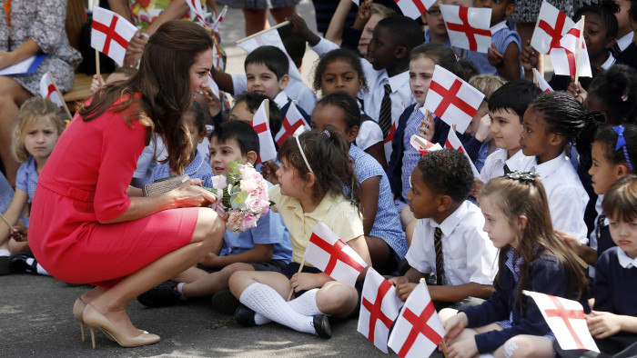 Britain's Catherine, Duchess of Cambridge, greets children of the Blessed Sacrament Catholic School in London July 1, 2014. Catherine, known as Kate, ...