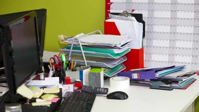 real life messy desk in office;