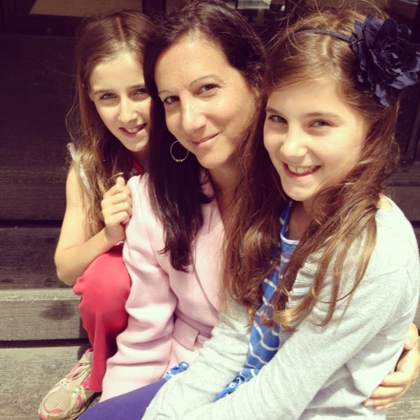 TODAY producer Tammy Fine with her twin daughters Abigail and Elizabeth.