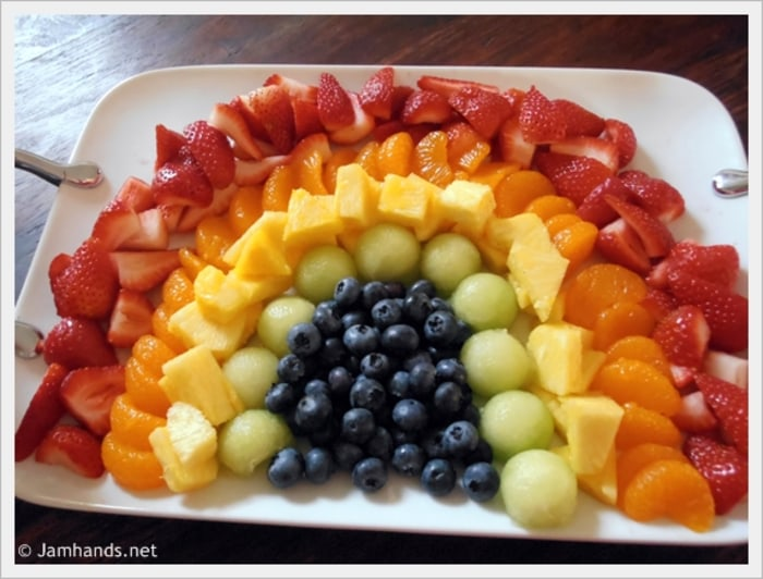 Fruit arranged in a rainbow
