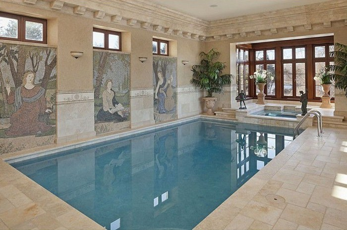 A large indoor pool and spa sit in the center of the home.