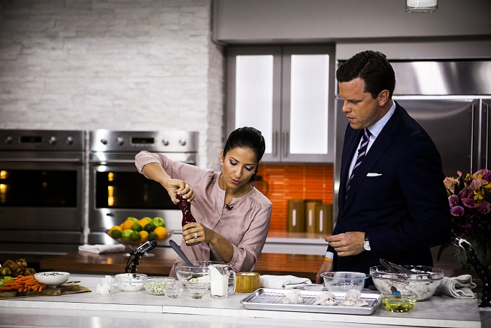 Laura Vitale and Willie Geist cook chicken wings on the TODAY show in New York, on July 7, 2014.