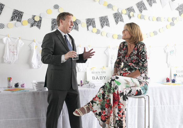 The cute couple: Mike Feldman says a few words at wife Savannah Guthrie's baby shower.