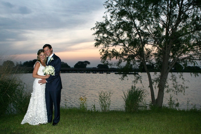 Jenna and her husband, Henry Hager, pose along the lake at Prairie Chapel Ranch following their wedding ceremony on May 10, 2008.