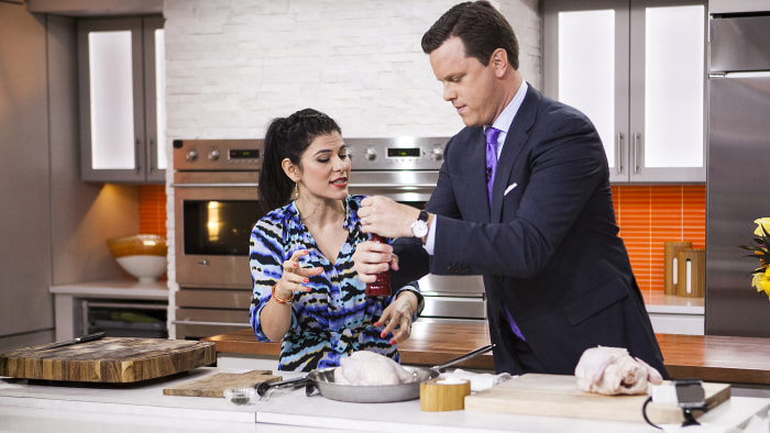 Nilou Motamed and Willie Geist cook  Thomas Keller's roasted chicken on the TODAY show in New York, on July 10.