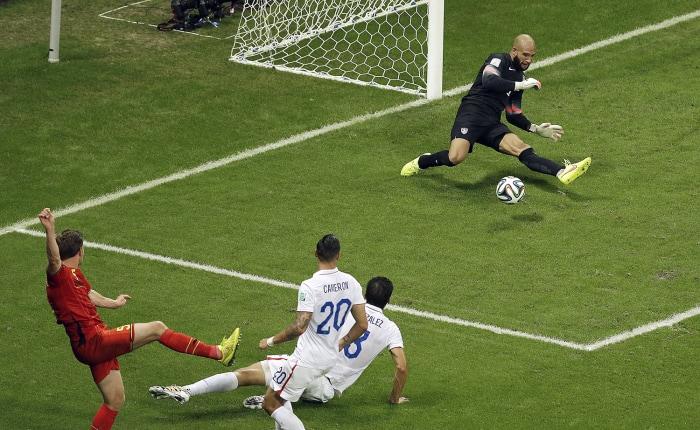 IMAGE: US goalkeeper Tim Howard stops a shot