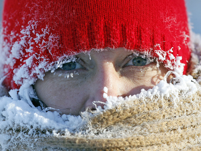 Ice from the breath of Gail Davis forms around her face as she exercises by walking outside in Minneapolis, January 8, 2014.  A deadly blast of arctic...