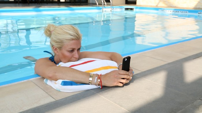 Checking the phone -- even in the pool.