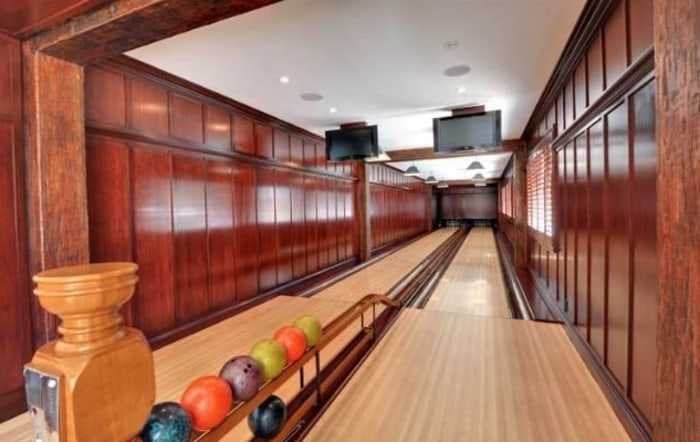 A lot of features fit in nearly 10,000 square feet of living space, like this bowling alley.