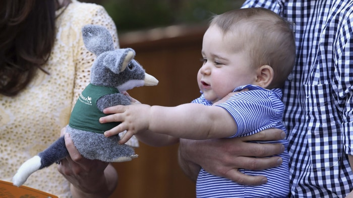 Britain's Prince George holds a toy Bilby during a visit to Taronga Zoo in Sydney, Australia April 20, 2014. Prince William and his wife Catherine, th...