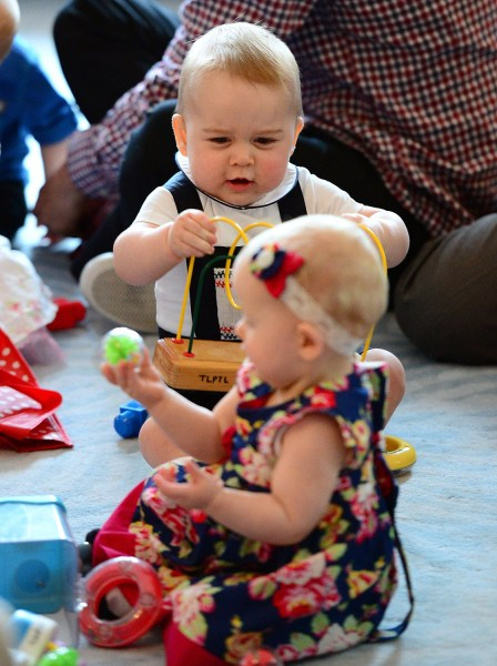 Prince George plays with toys alongside other babies while attending a parenting group at the Government House on April 9, 2014 in Wellington, New Zealand.