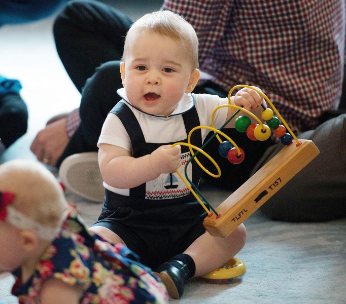 epa04315293 (FILE) A file picture dated 09 April 2014 shows Britain's Prince George playing with the toys during a Plunket nurse and parents group vis...