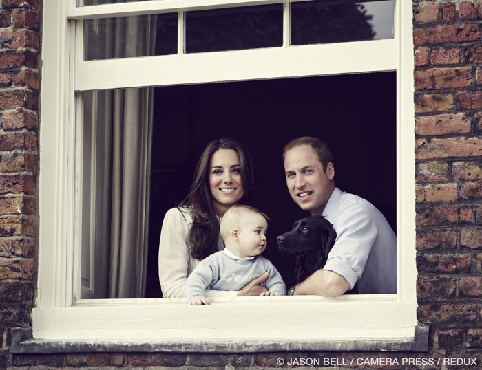 The Duke and Duchess of Cambridge with their son Prince George and their dog Lupo, photographed at Kensington Palace in March 2014.
