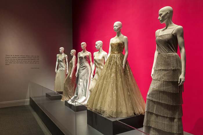 Gowns lined up at the Bush Center's Oscar de la Renta exhibit.