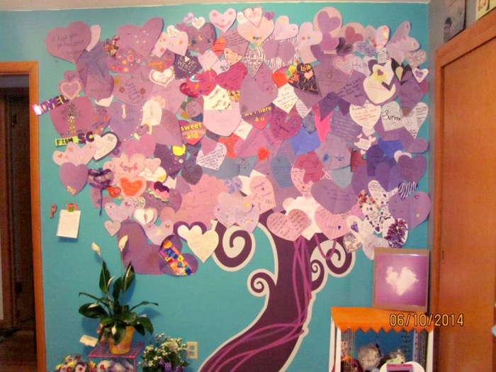 "A local artist drew a tree trunk — the canopy of ""leaves"" of the design in the wounded girl's room consists of purple hearts sent from people from aro..."