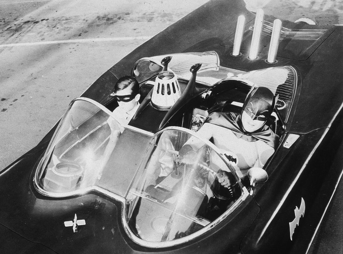 Adam West and Burt Ward as Batman and Robin in the 1960s TV version of the Batmobile.