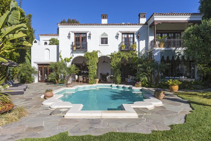 The swimming pool on the $10.99 million property was modeled after a coat of arms in Spain.