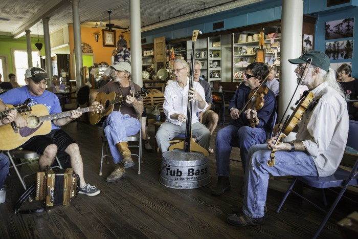 Musicians meet for a Cajun jam session at Joie de Vivre Cafe in Breaux Bridge, Louisiana.