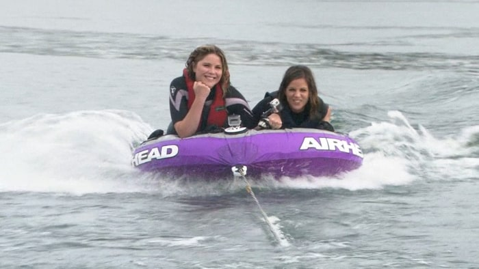 Jenna and Natalie go tubing on the lake.