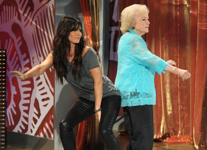 Image: Betty White and Sandra Bullock dancing in 2012