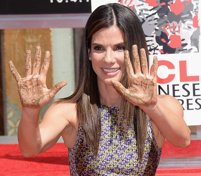Image: Sandra Bullock poses for a photo as she is immortalized with a hand and footprint ceremony at TCL Chinese Theatre