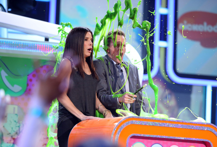 Actress Sandra Bullock and actor Neil Patrick Harris speak onstage during Nickelodeon's 26th Annual Kids' Choice Awards in 2013