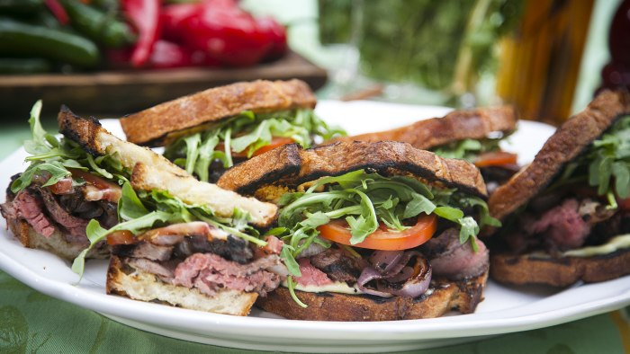 Guy Turland and Carson Daly make jerk chicken and steak sandwiches on the TODAY show as part of the Fresh Cooks Live: Summer Sizzle series in New York...