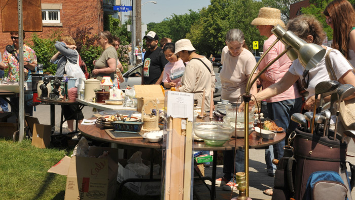 OTTAWA, CANADA - MAY 26: Thousands of people gather at the annual Glebe neighborhood garage sale which takes place for several blocks in the Glebe are...
