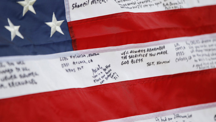 A detail of Lance Cpl. Fred Maciel's flag made in his honor was found by Lanie and Walter Brown at a flea market and presented to his mother, Saturday...