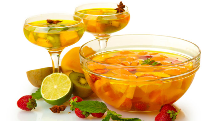 punch in bowl and glasses with fruits, isolated on white; Shutterstock ID 112375988; PO: today.com