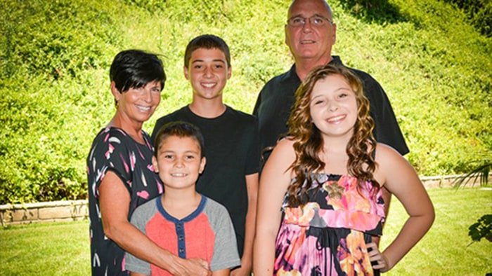 Steve Mason, top right, and Darnelle Mason, far left, are struggling to pay off their late daughter's student loan debt, which they say totals more than $200,000, while raising her three children. In turn, the family is campaigning for student loans to discharged in the event of bankruptcy.