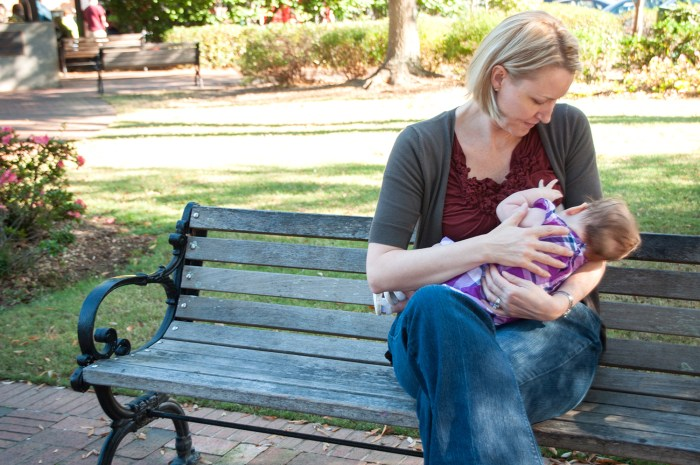 Heather Davis nurses her daughter.