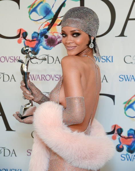 Rihanna poses with her award in one of the few photos that we can post here.